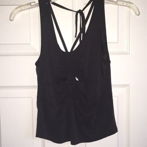 Free People charcoal gray strappy tank w cutouts